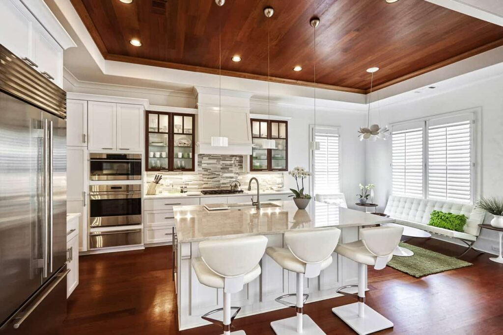 image of an all-white kitchen with red wood floor and ceiling