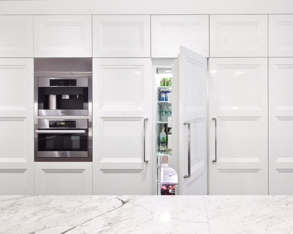 Fridge hidden withing the cabinetry to increase small kitchen space