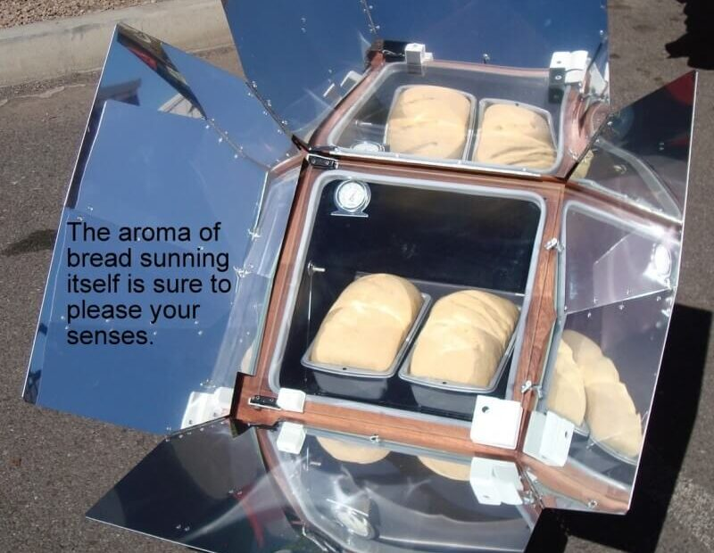 image of a sun oven working under the sun to explain what a sun oven is and how it works